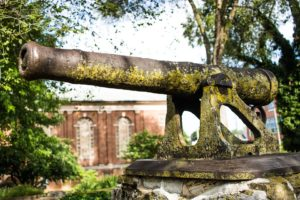 A moss-covered old cannon.