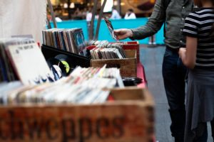 A street vendor selling records